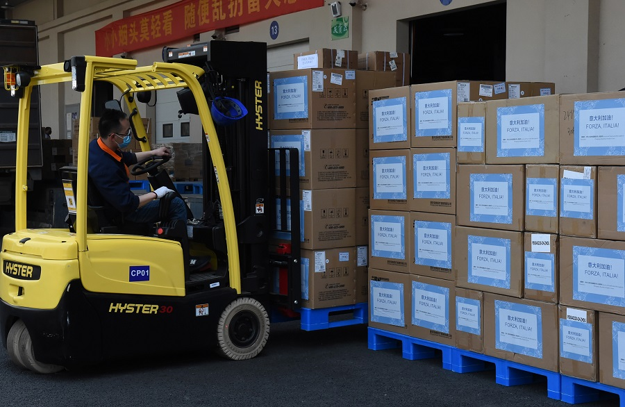 """Boxes of donated medical supplies from Chongqing to Italy are seen in this photo taken on 19 March 2020. The note written in both Chinese and Italian on the boxes reads: """"Italy, you can do it!"""" (CNS)"""
