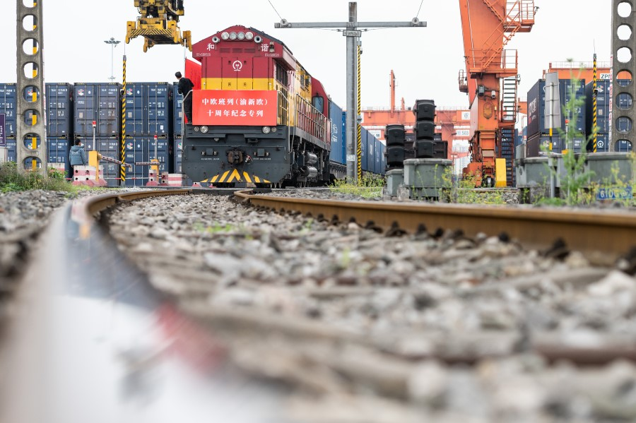 A train on the Trans-Eurasia Express under the China Railway Express, leaving a logistics centre in Chongqing, 27 July 2021. (CNS)