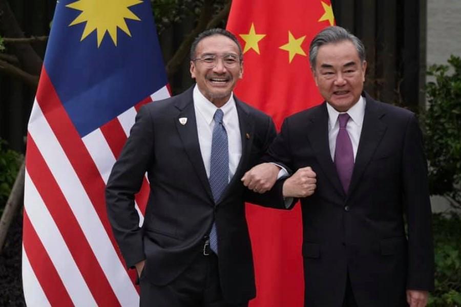 Malaysia's Foreign Minister Hishammuddin Hussein with China's Foreign Minister Wang Yi, 1 April 2021. (Hishammuddin Hussein/Facebook)