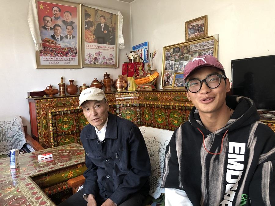 Young Tibetan Danzeng Duoji (right) has no plans to go back to the farm.