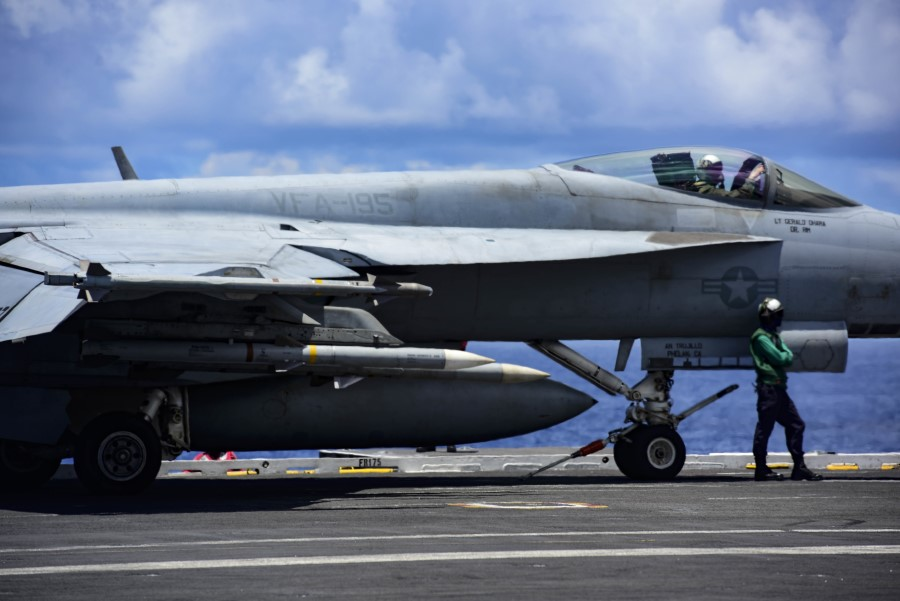 An aircraft prepares to launch off the flight deck of carrier USS Ronald Reagan while conducting operations in the South China Sea, 14 August 2020. (US Navy Mass Communication Specialist 3rd Class Jason Tarleton/US navy website)