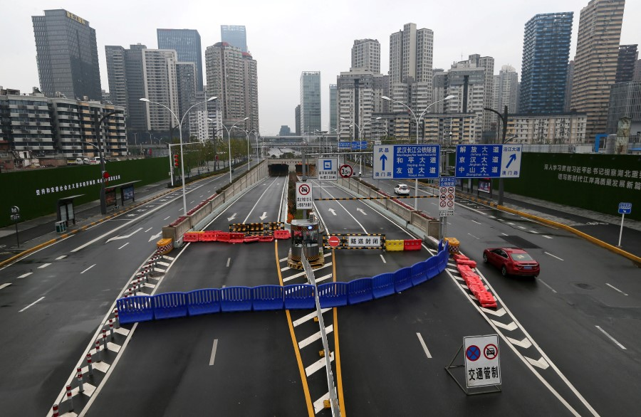 Wuhan Yangtze River Tunnel is blocked with a barrier during the lockdown on Wuhan. (Reuters)
