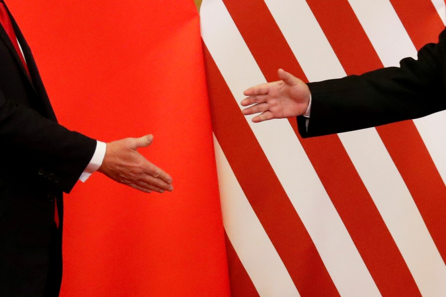 US President Donald Trump and China's President Xi Jinping shake hands after making joint statements at the Great Hall of the People in Beijing, November 2017. (Damir Sagolj/REUTERS)