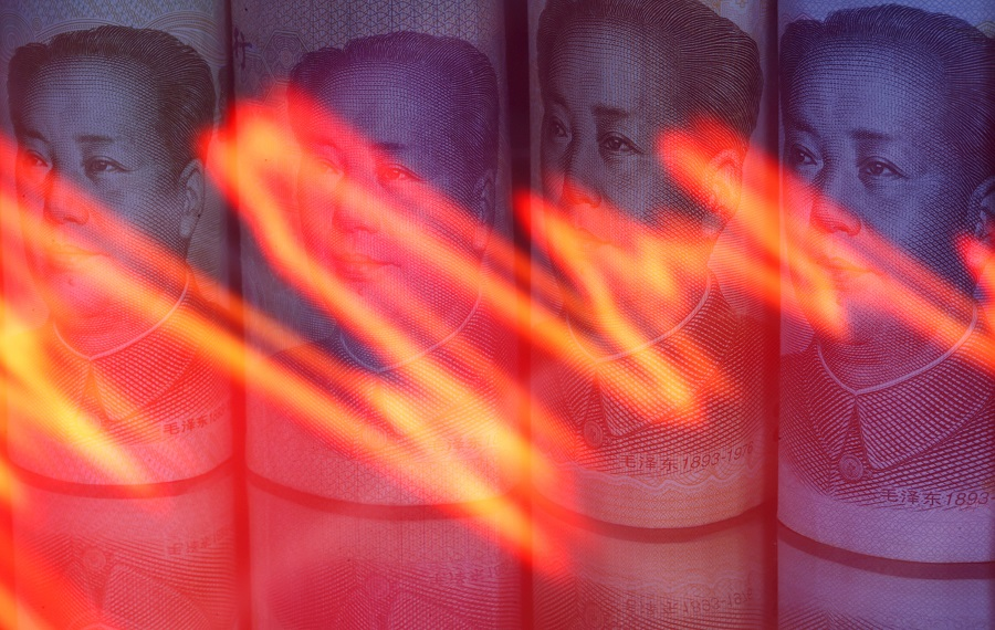 Chinese RMB banknotes are seen behind an illuminated stock graph in this illustration taken on 10 February 2020. (Dado Ruvic/Illustration/File Photo/Reuters)