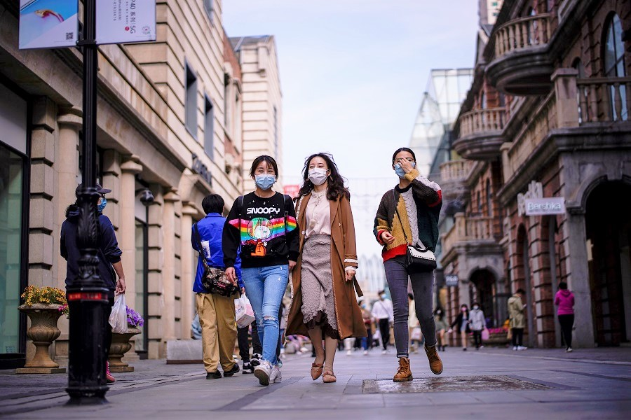 China can easily face a passive disadvantage in handling its external relations if callow nationalists gain control of the Internet. In this photo taken on 14 April 2020, people wearing face masks are seen at a main shopping area after the lockdown was lifted in Wuhan, China. (Aly Song/Reuters)