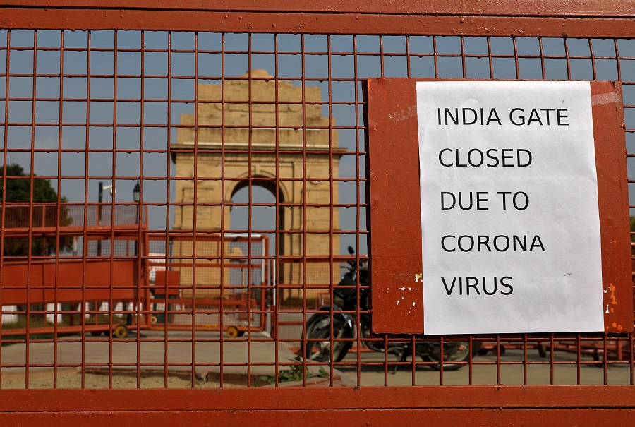 A sign pasted on a security barricade is seen after the India Gate war memorial was closed for visitors amid measures for coronavirus prevention in New Delhi, India, on 19 March 2020. (Adnan Abidi/File Photo/Reuters)