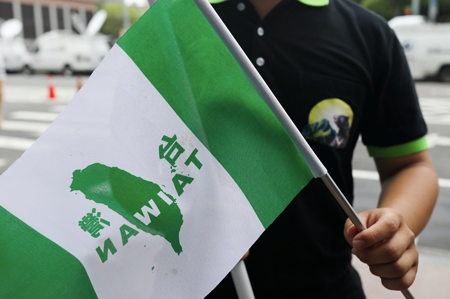 A protester calling for Taiwan independence waves a flag in front of Democratic Progressive Party in Taipei, Taiwan, on 20 May 2020. (Ann Wang/Reuters)