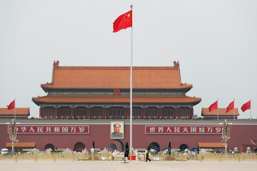 The Chinese flag flutters on Tiananmen Square before the opening session of the Chinese People's Political Consultative Conference (CPPCC) in Beijing, 21 May 2020. (Carlos Garcia Rawlins/REUTERS)