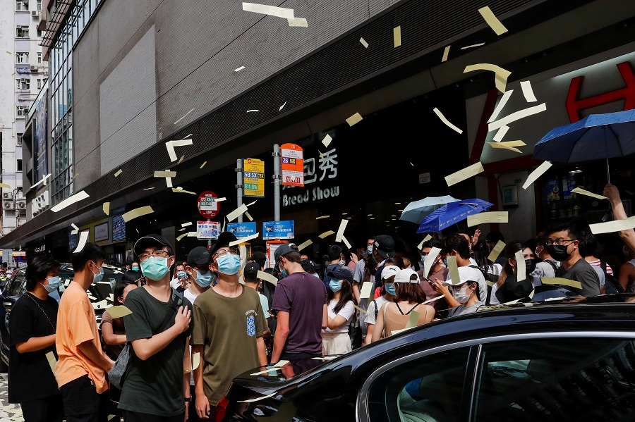 Anti-national security law protesters throw mock paper money during a march against national security law on the anniversary of Hong Kong's handover to China from Britain, in Hong Kong, China, 1 July 2020. (Tyrone Siu/Reuters)