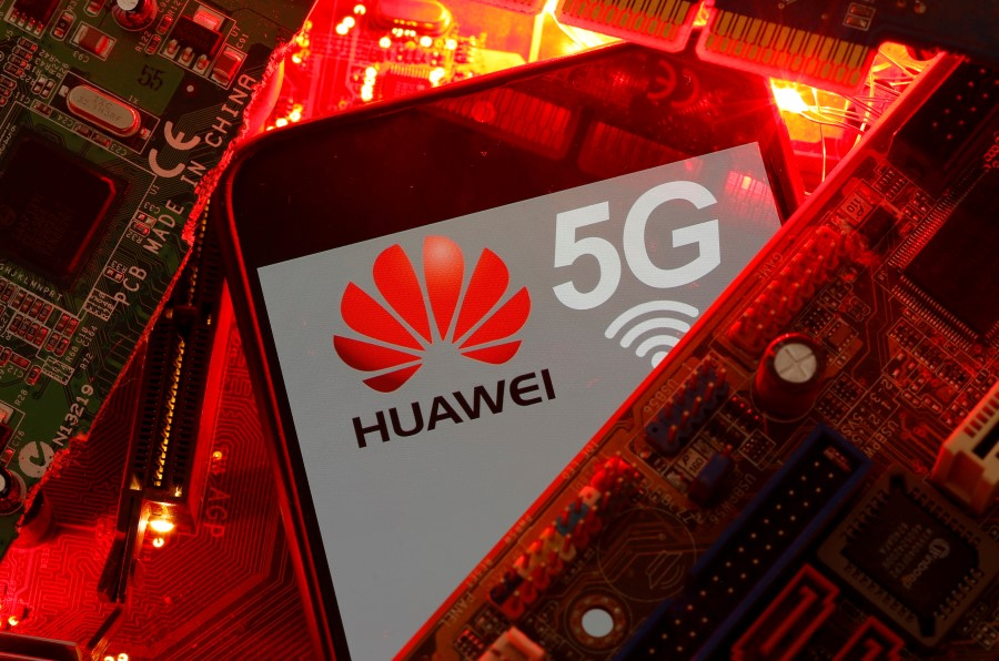 A smartphone with the Huawei and 5G network logo is seen on a PC motherboard in this illustration picture, 29 January 2020. (Dado Ruvic/REUTERS)