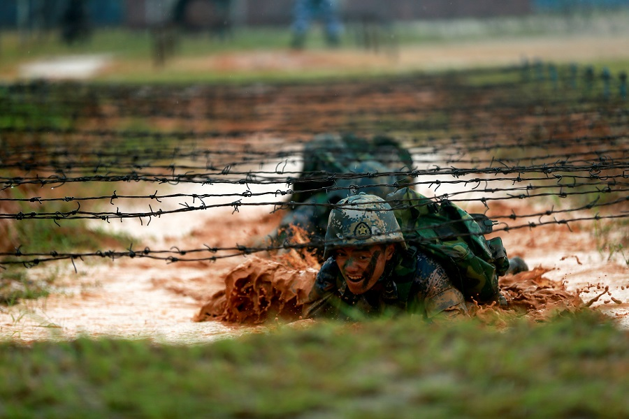 Soldiers of the People's Liberation Army (PLA) Marine Corps are seen in training in Zhanjiang, Guangdong province, China, 20 July 2017. (Stringer/File Photo/Reuters)