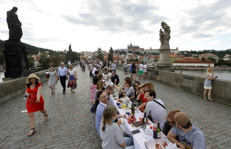 Residents dine at a 500-metre-long table spanning across the length of the medieval Charles Bridge as restrictions ease following the coronavirus disease (COVID-19) outbreak, in Prague, Czech Republic, 30 June 2020. (David W Cerny/REUTERS)