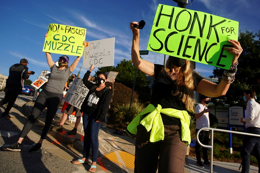 Protesters against US President Donald Trump rally outside the Centers for Disease Control and Prevention (CDC) in Atlanta, Georgia, US, 21 September 2020. (Elijah Nouvelage/Reuters)