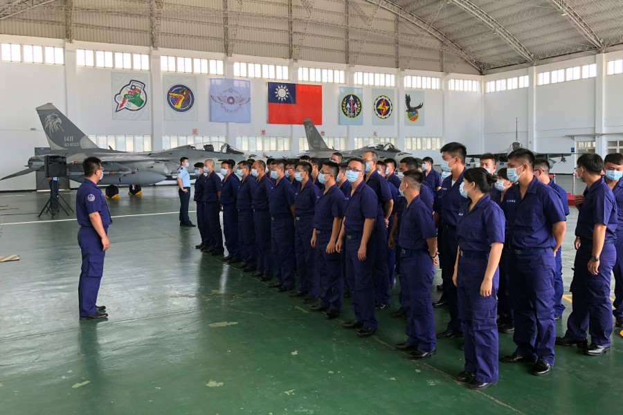 Soldiers gather in front of Indigenous Defense Fighter (IDF) fighter jets at Makung Air Force Base in Taiwan's offshore island of Penghu, 22 September 2020. (Yimou Lee/REUTERS)