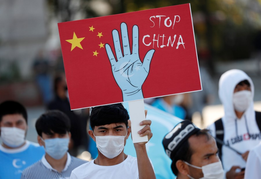 Ethnic Uighur demonstrators take part in a protest against China and its treatment of Uighurs in Xinjiang, in Istanbul, Turkey, 1 October 2020. (Murad Sezer/REUTERS)