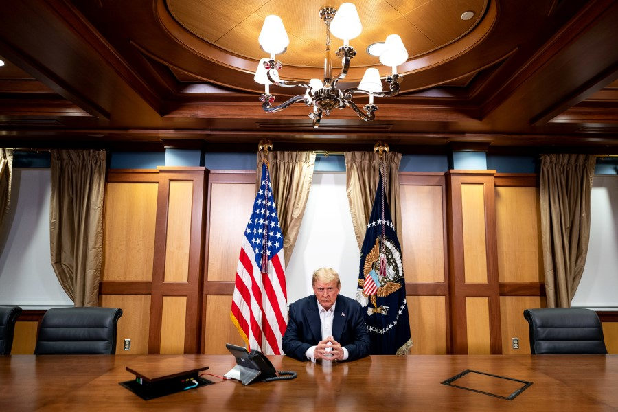 US President Donald Trump participates in a phone call with Vice President Mike Pence, Secretary of State Mike Pompeo, and Chairman of the Joint Chiefs of Staff Gen. Mark Milley, 4 October 2020, in his conference room at Walter Reed National Military Medical Center in Bethesda, Maryland. (Tia Dufour/The White House/Handout via REUTERS)