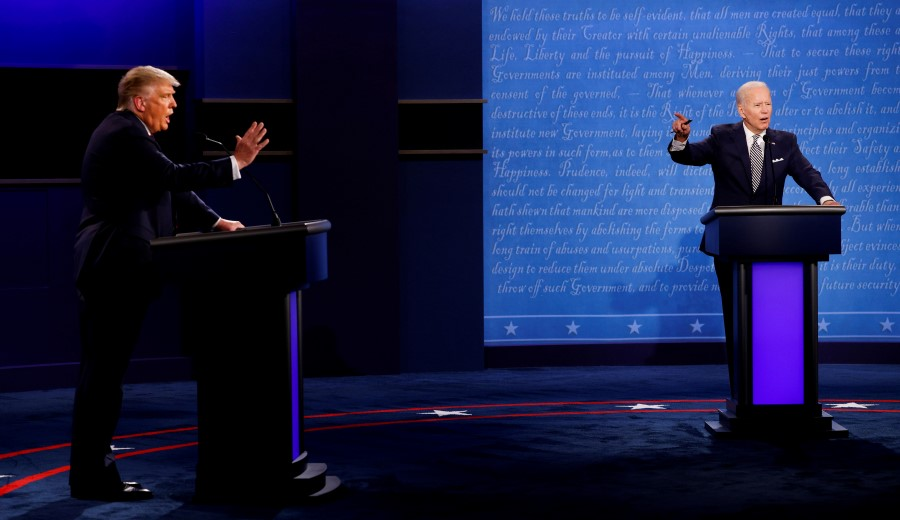 US President Donald Trump and Democratic presidential nominee Joe Biden participate in their first 2020 presidential campaign debate held on the campus of the Cleveland Clinic at Case Western Reserve University in Cleveland, Ohio, US, 29 September 2020. (Brian Snyder/REUTERS)