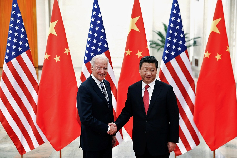 In this file photo taken on 4 December 2013, Chinese President Xi Jinping shakes hands with then-US Vice President Joe Biden (left) inside the Great Hall of the People in Beijing, China. Since his inauguration, Biden has yet to speak to Xi on the phone. (Lintao Zhang/Pool/File Photo/Reuters)
