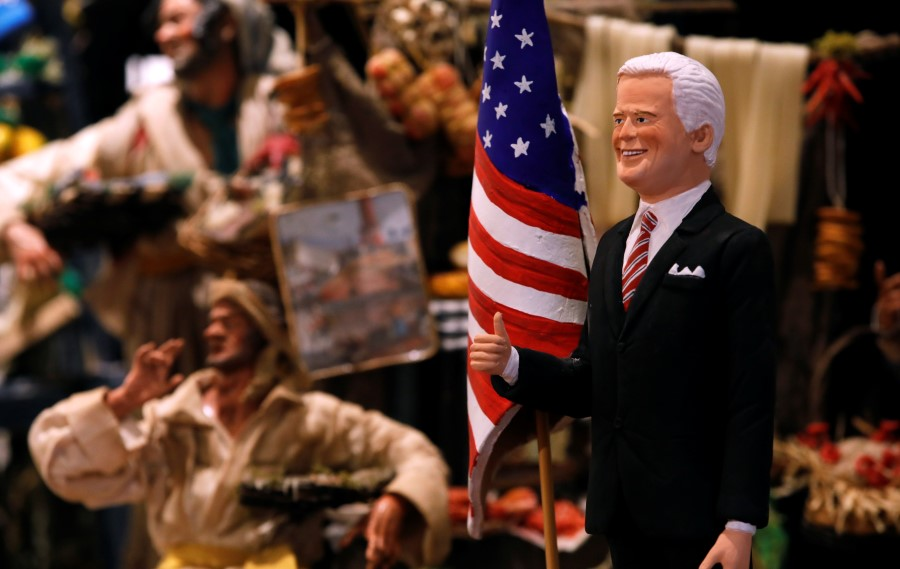 A figurine depicting U.S. President-Elect Joe Biden is pictured at a shop on Via San Gregorio Armeno, the famous street in Naples dedicated to producing nativity figurines, where shops are currently closed due to the coronavirus disease (COVID-19) restrictions, in Naples, Italy, 19 November 2020. (Ciro De Luca/REUTERS)