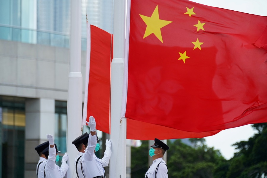 Members of the Hong Kong Police Honour Guard raise flags during a flag-raising ceremony marking China's National Day at Golden Bauhinia Square in Hong Kong, China, 1 October 2020. (Lam Yik/File Photo/Reuters)