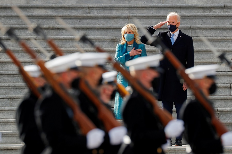 US President Joe Biden salutes as first lady Jill Biden puts her hand over her heart during the pass in review after the inauguration ceremony, in Washington, US, 20 January 2021. (Mike Segar/Reuters)