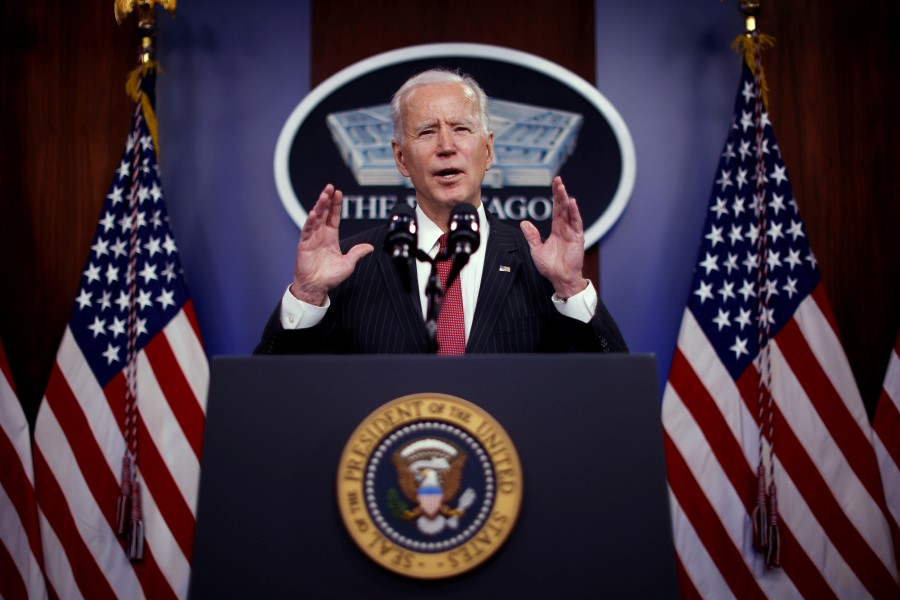 US President Joe Biden delivers remarks to Defense Department personnel during a visit to the Pentagon in Arlington, Virginia, US, 10 February 2021. (Carlos Barria/Reuters)