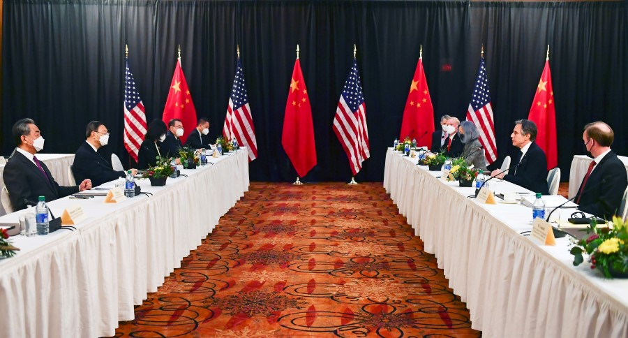 US Secretary of State Antony Blinken (second from right) and national security adviser Jake Sullivan (right) speak with Politburo member and director of the Office of the Central Commission for Foreign Affairs Yang Jiechi (second from left) and State Councilor and Foreign Minister Wang Yi (left) at the opening session of US-China talks at the Captain Cook Hotel in Anchorage, Alaska, US, 18 March 2021. (Frederic J. Brown/Pool via Reuters)