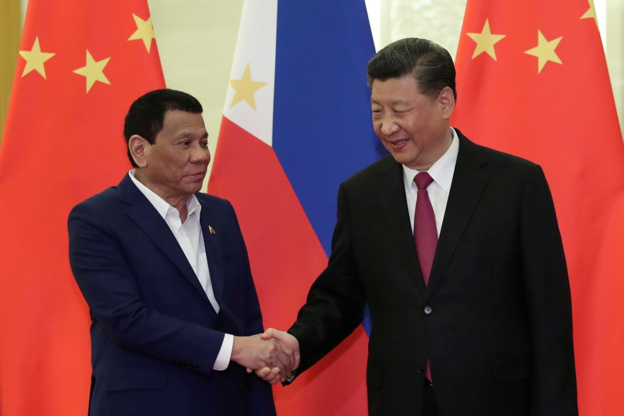 Philippine President Rodrigo Duterte shakes hands with Chinese President Xi Jinping before their meeting at the Great Hall of People in Beijing,Chinaon 25 April 2019. (Kenzaburo Fukuhara/Pool via Reuters)