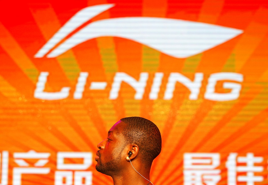NBA Miami Heat's Dwyane Wade stands in front of a company logo of Li-Ning during a promotional event for Li-Ning's Way of Wade sneakers, in Beijing, 3 July 2013. (Barry Huang/File Photo/Reuters)