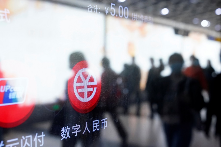 A sign indicating digital RMB is pictured on a vending machine at a subway station in Shanghai, China, 21 April 2021. (Aly Song/Reuters)
