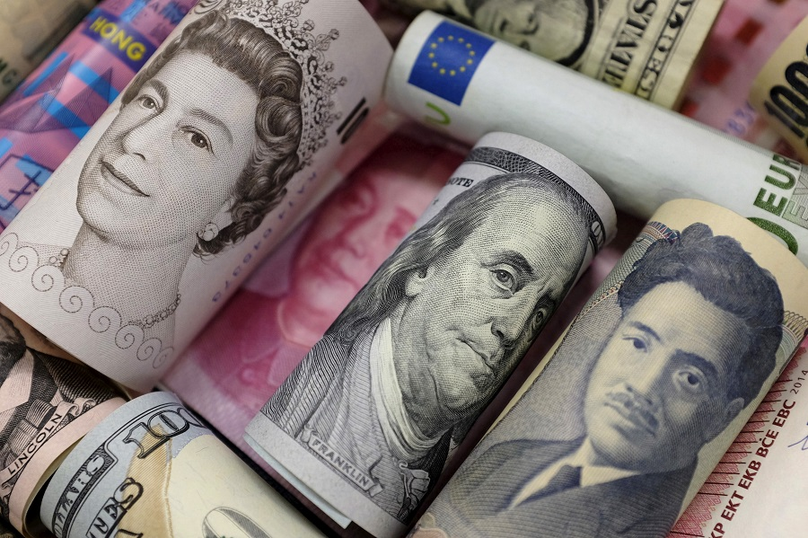 A picture illustration of the banknotes of the euro, HK dollar, US dollar, Japanese yen, British pound and Chinese yuan. (Jason Lee/File Photo/Reuters)