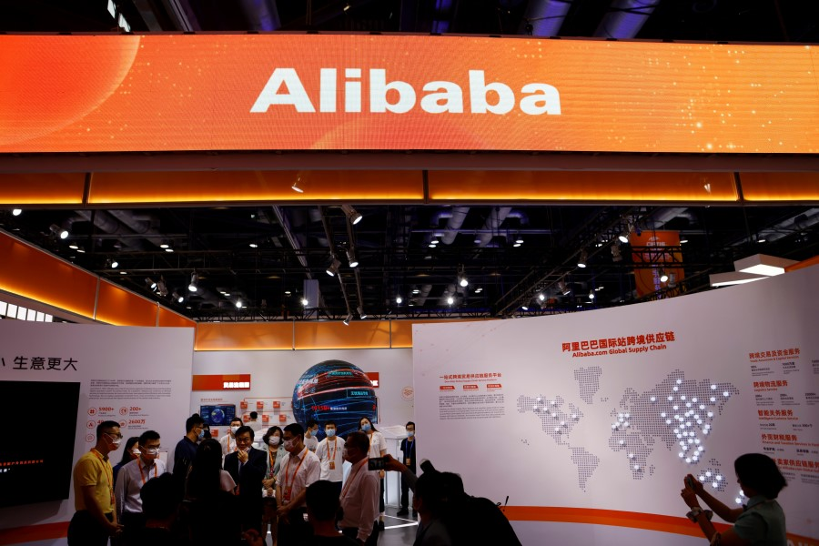 People visit the Alibaba booth during the 2021 China International Fair for Trade in Services (CIFTIS) in Beijing, China, 4 September 2021. (Florence Lo/Reuters)