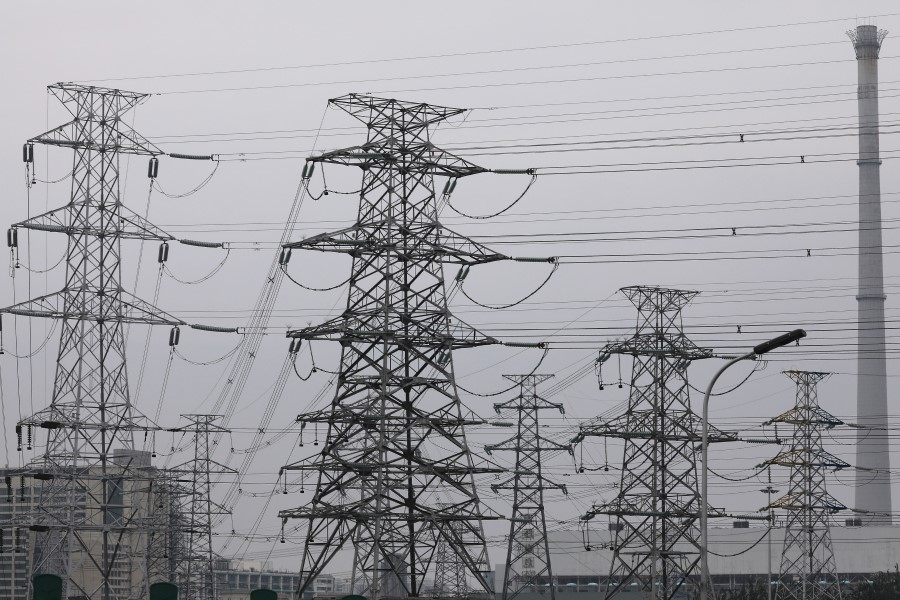 Electricity transmission towers are pictured in Beijing, China, 28 September 2021. (Tingshu Wang/Reuters)