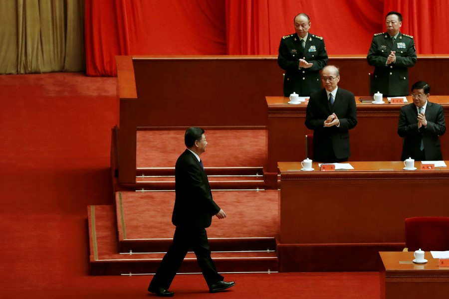 Chinese President Xi Jinping arrives for a meeting commemorating the 110th anniversary of Xinhai Revolution at the Great Hall of the People in Beijing, China, 9 October 2021. (Carlos Garcia Rawlins/Reuters)