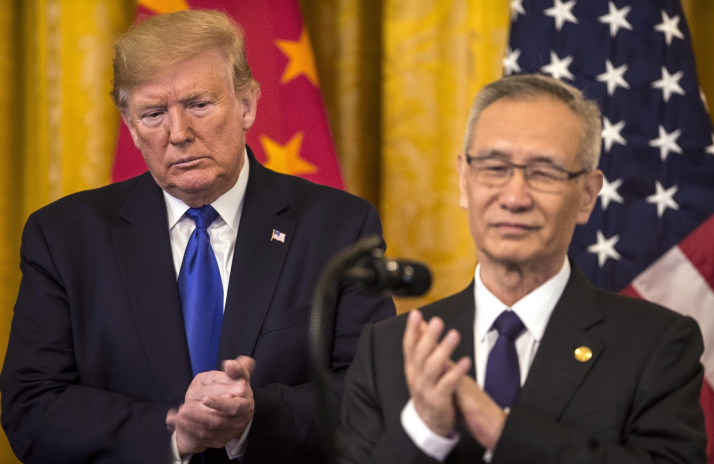 US President Donald Trump applauds as Liu He, China's vice premier, speaks during a signing ceremony for the US-China phase-one trade agreement in Washington on 15 January 2020. (Zach Gibson/Bloomberg)