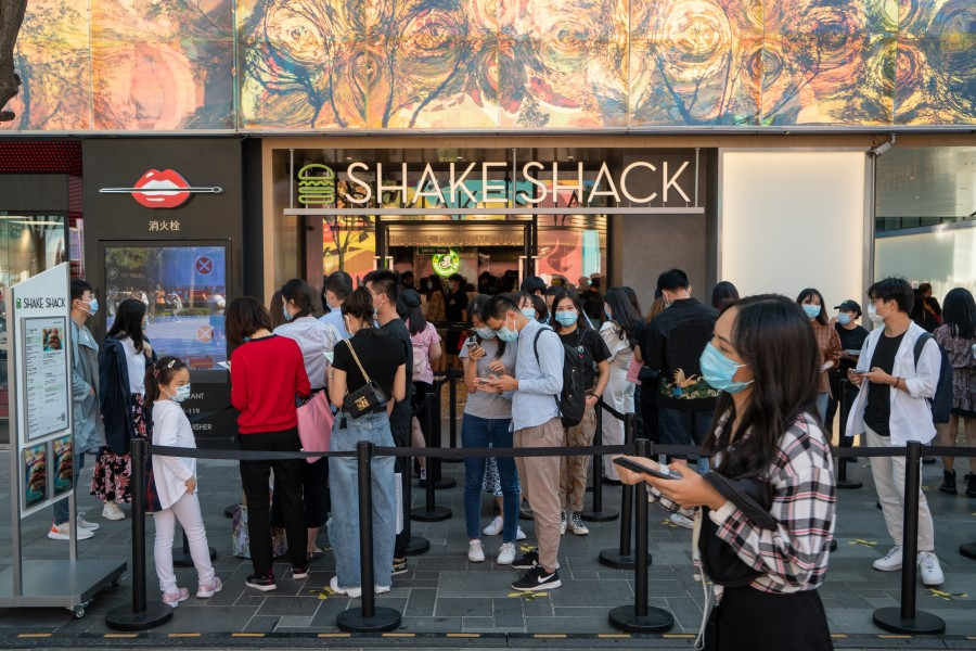 Customers wait in line outside a Shake Shack Inc. restaurant in Beijing, China on 20 September 2020. (Yan Cong/Bloomberg)