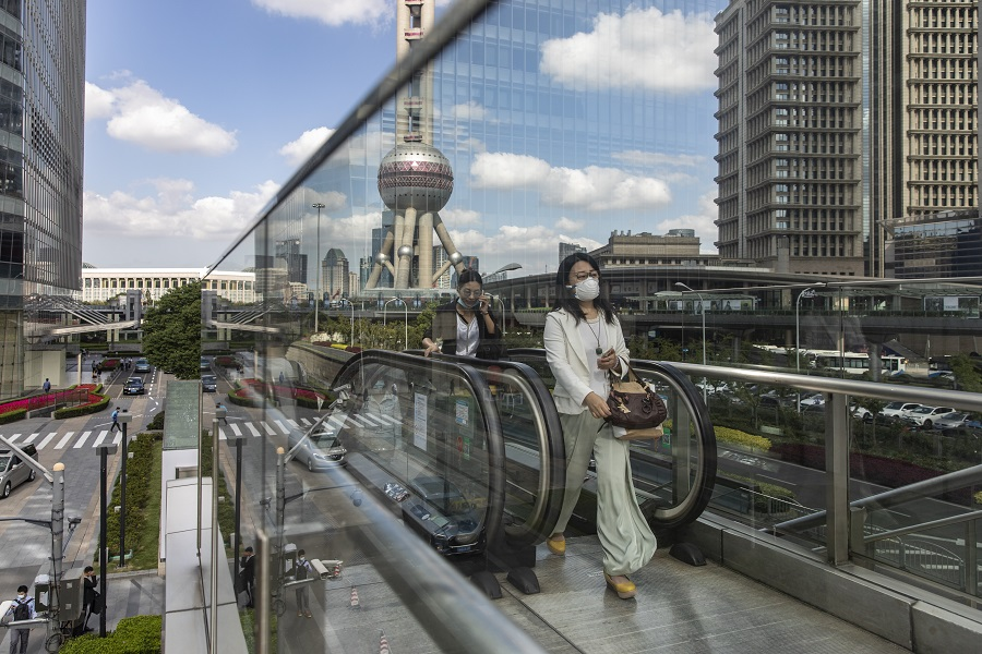 Morning commuters ride an escalator in the Lujiazui Financial District in Shanghai, China, on 9 October 2020. (Qilai Shen/Bloomberg)