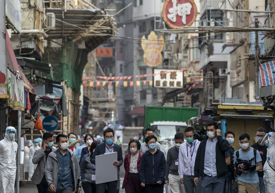 Carrie Lam, Hong Kong's chief executive, centre, walks in an area under lockdown in the Jordan area of Hong Kong, China, on 23 January 2021. (Paul Yeung/Bloomberg)