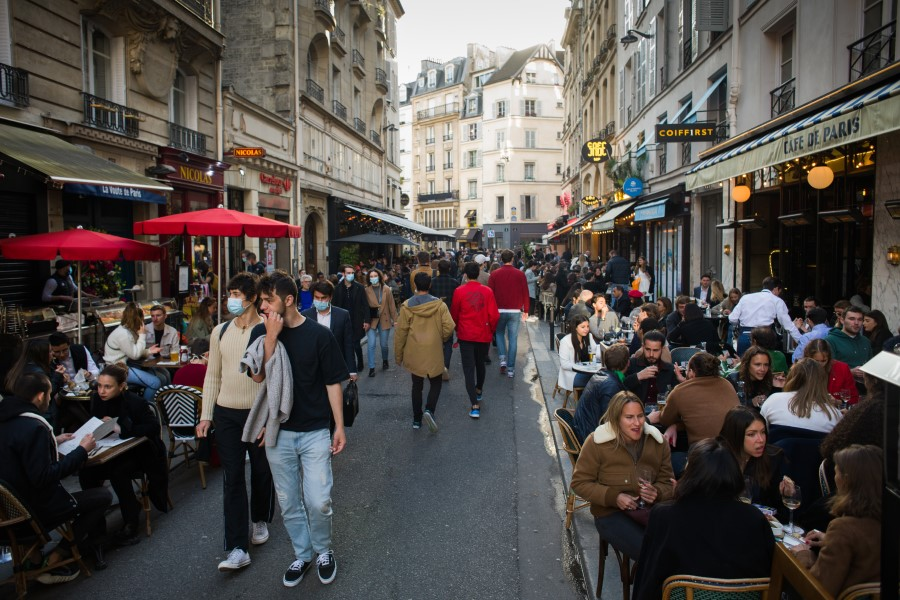 Customers drink on reopened cafe terraces on Saint Germain in Paris, France, on 19 May 2021. (Nathan Laine/Bloomberg)