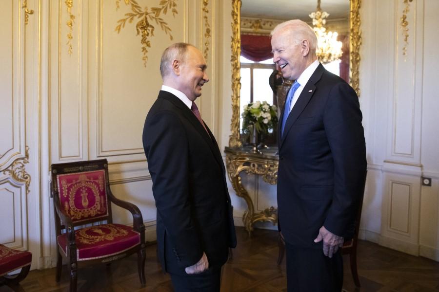 Vladimir Putin, Russia's president, left, and U.S. President Joe Biden, right, react at the start of the U.S. Russia summit at Villa La Grange in Geneva, Switzerland, on 16 June 2021. (Peter Klaunzer/Swiss Federal Office of Foreign Affairs/Bloomberg)