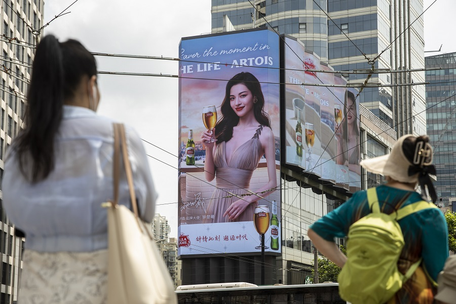 A public screen displays an advertisement for Stella Artois beer in Shanghai, China, on 18 August 2021. (Qilai Shen/Bloomberg)