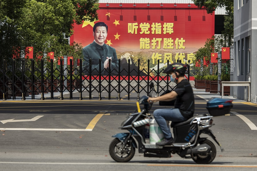 A billboard featuring Chinese President Xi Jinping is displayed at a compound in Shanghai, China, on 30 August 2021. (Qilai Shen/Bloomberg)