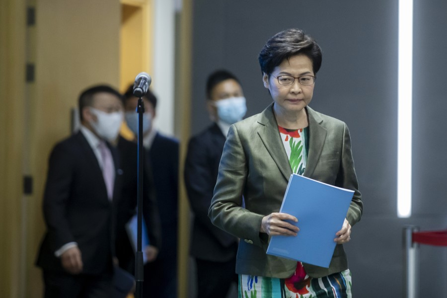 Carrie Lam, Hong Kong's chief executive, arrives for a news conference in Hong Kong, China, on 6 October 2021. In the last annual policy address of her current term, Lam announced plans to transform the northern part of the New Territories. (Paul Yeung/Bloomberg)