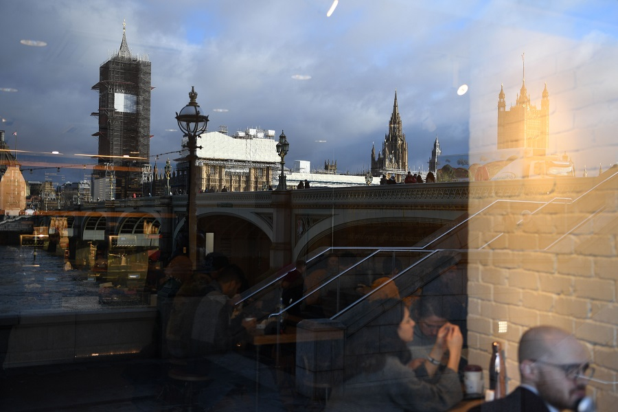 Big Ben and the Houses of Parliament are seen reflected in a cafe window during ongoing renovations to the Tower and the Houses of Parliament, in central London on 17 January 2020. (Daniel Leal-Olivas/AFP)
