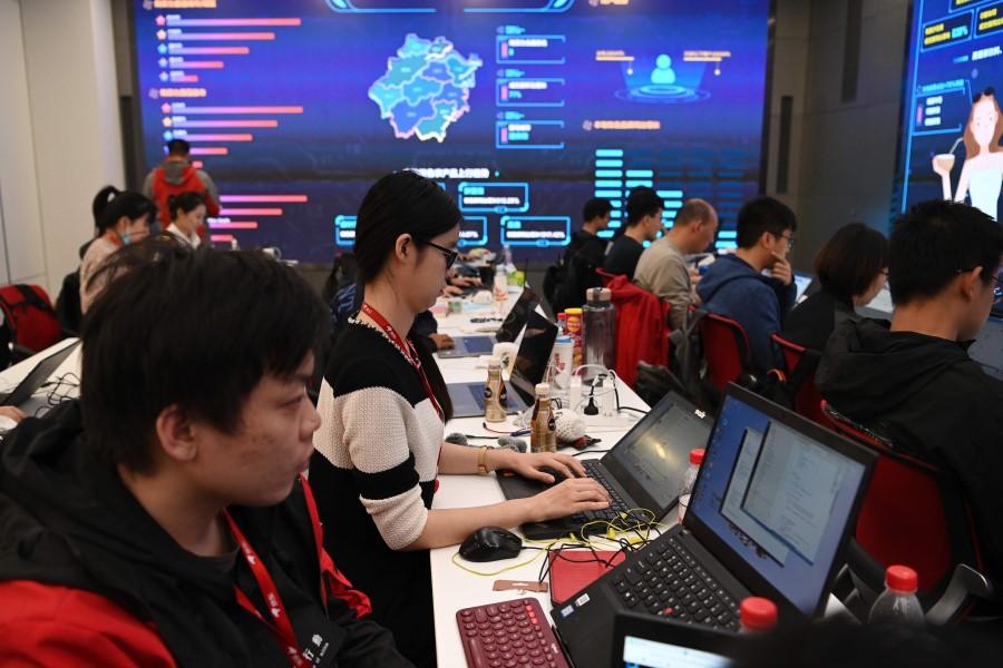 Data room operators work at the headquarters of online shopping platform JD.com during the Singles' Day shopping festival in Beijing on 11 November 2020. (Greg Baker/AFP)
