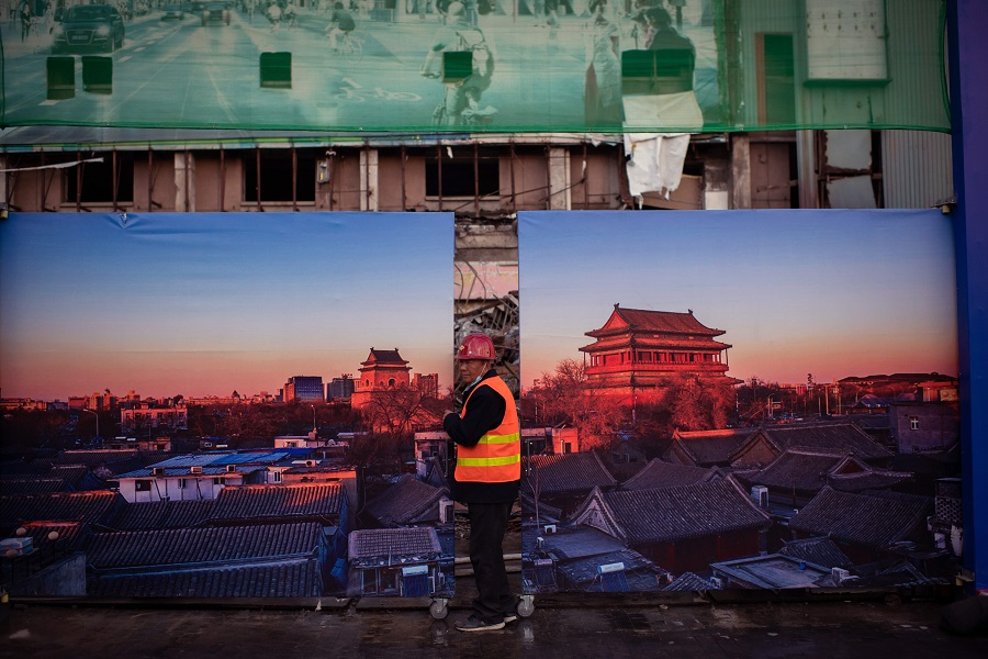 A worker leaves a construction site in Beijing on 28 October 2020. (Nicolas Asfouri/AFP)