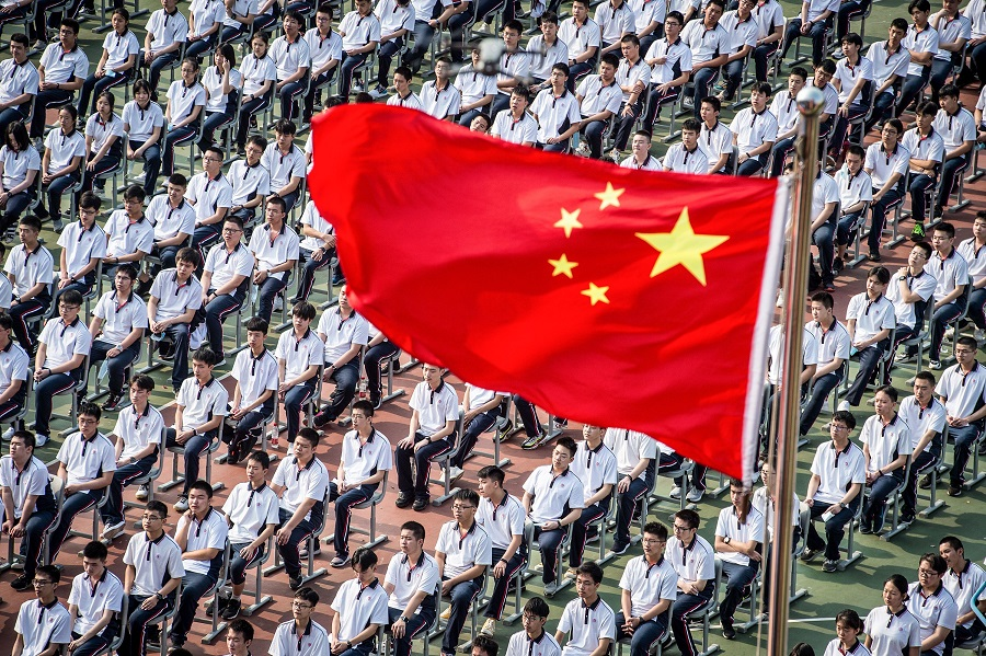 Students attend the 100th anniversary of the founding of Wuhan High School on the first day of the new semester in Wuhan, Hubei, China, on 1 September 2020. (STR/AFP)