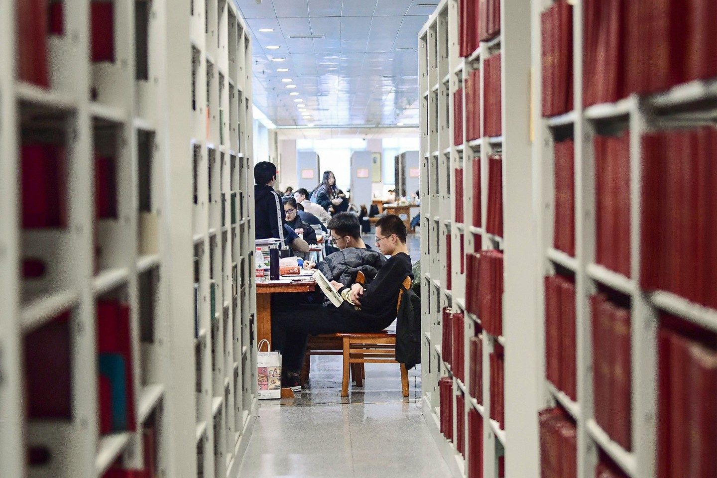Examinations play a huge role in China society. This photo taken on November 26, 2019 shows university students preparing for the upcoming National Postgraduate Entrance Exam (NPEE) at a library in Shenyang in China's northeastern Liaoning province. (STR/AFP)