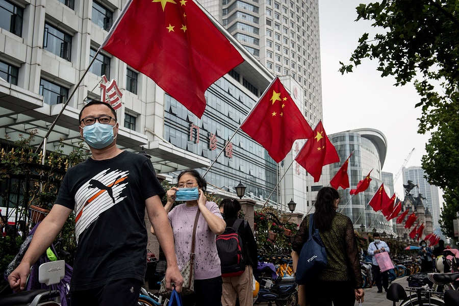 People walk along a street in Wuhan, Hubei, China on 29 September 2020. (STR/AFP)