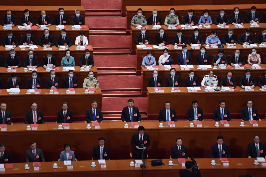 National People's Congress Chairman Li Zhanshu (bottom C) speaks as Chinese President Xi Jinping (C) and other Chinese leaders look on during the closing session of the National People's Congress at the Great Hall of the People in Beijing, 28 May 2020. (Nicolas Asfouri/AFP)